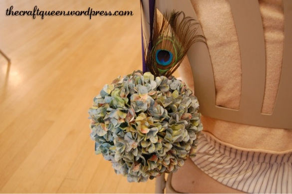 peacock feather pomander aisle decoration