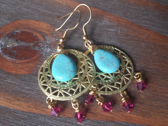 Gold chandelier earrings with hot pink Swarovski crystals and hand-wrapped turquoise howlite, $14