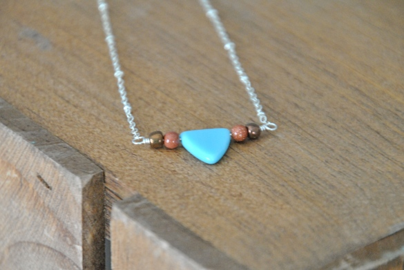 Find it on Etsy here: https://www.etsy.com/listing/212955587/blue-geometric-triangle-necklace